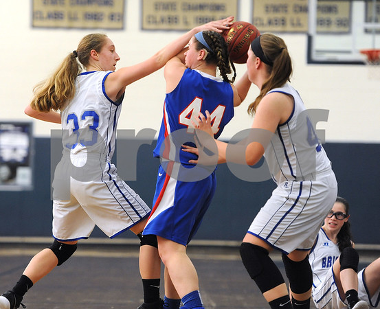 1/20/2018 Mike Orazzi | Staff Plainville's Krystyna Miller (44) and Bristol Eastern's Jordan Ouellette (33) and Avery Arbuckle (42) during Saturday's girls basketball game with Bristol Eastern in Bristol.