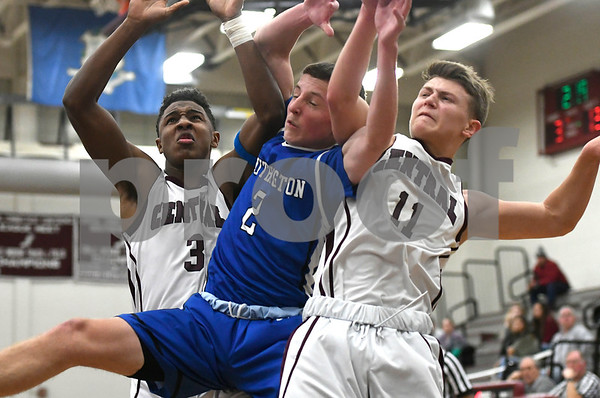 1/2/2018 Mike Orazzi | Staff Bristol Central's Dathan Hickey (3) Noah Plantamuro (11) and Southington's Ryan Gesnaldo (2) during the boys basketball game between in Bristol Tuesday night.