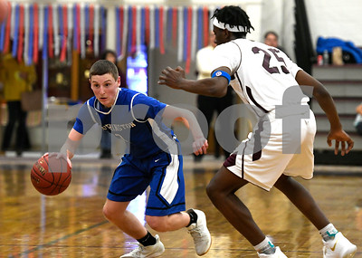 1/2/2018 Mike Orazzi | Staff Southington's Ryan Gesnaldo  (2) during the boys basketball game between in Bristol Tuesday night.