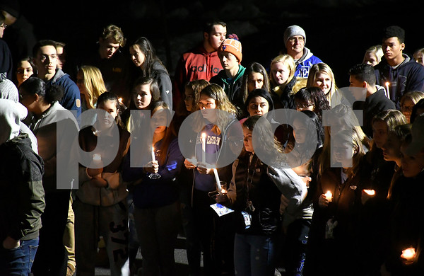 1/27/2018 Mike Orazzi | Staff Friends gather during a vigil at Bristol Eastern High School Saturday night for Kerion Rogers who was killed in a car crash last weekend.
