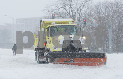 01/04/18  Wesley Bunnell | Staff  A blizzard featuring high winds and causing icy conditions hit CT throughout the day on Thursday. A pedestrian walks in the street where it is easier to walk as a snow plow clears the intersection of Main and East Main St.