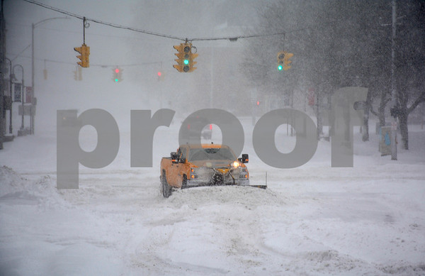 1/4/2018 Mike Orazzi | Staff A plow makes its way up Main Street in downtown Bristol during Thursday's snowfall.