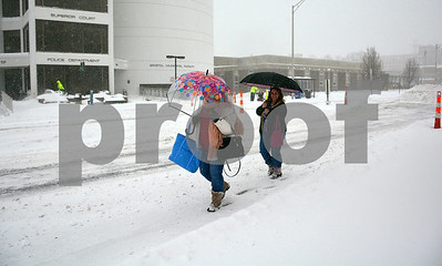 1/4/2018 Mike Orazzi | Staff Margaret Rodziewicz and Terri Malenfant walk along North Main Street in downtown Bristol during Thursday's snowfall.