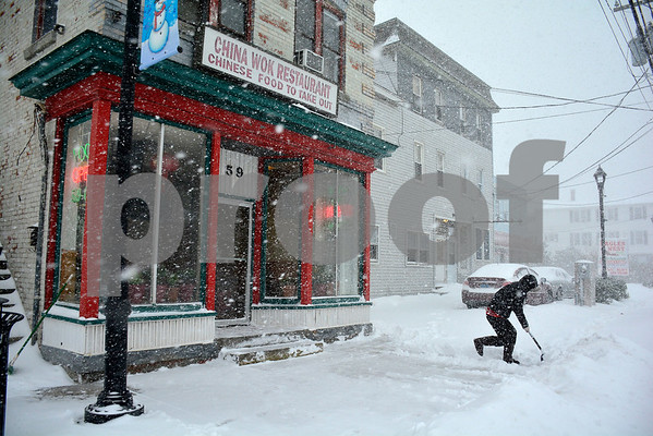 1/4/2018 Mike Orazzi | Staff Xiu G Xie while shoveling snow along Route 6 in Terryville in front of the China Wok Restaurant in Terryville Thursday morning.