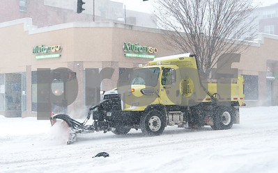 01/04/18  Wesley Bunnell | Staff  A blizzard featuring high winds and causing icy conditions hit CT throughout the day on Thursday.  A snow plow makes its way down West Main St.