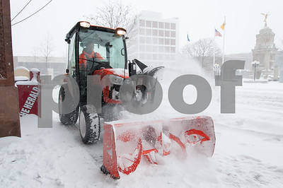 01/04/18  Wesley Bunnell | Staff  A blizzard featuring high winds and causing icy conditions hit CT throughout the day on Thursday. A snow thrower clears the sidewalk in front of city hall.
