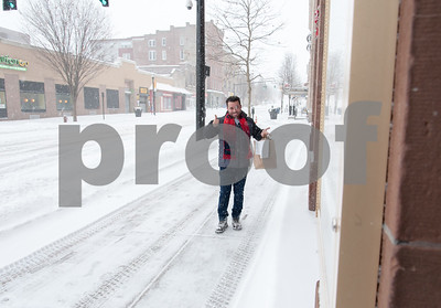 01/04/18  Wesley Bunnell | Staff  A blizzard featuring high winds and causing icy conditions hit CT throughout the day on Thursday.  Owner of Mofongo Restaurant Vincent Placeres gives the thumbs up as he makes his way towards city hall with a food delivery.