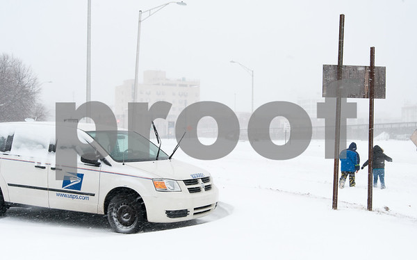 01/04/18 Wesley Bunnell | Staff A blizzard featuring high winds and causing icy conditions hit CT throughout the day on Thursday. Pedestrians are forced to walk down down the middle of Chestnut Street on Thursday due to heavy snow covering the sidewalk just past the post office.