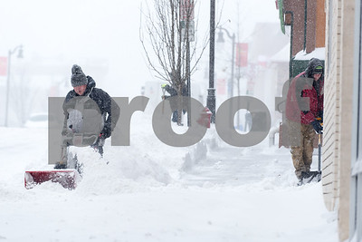 01/04/18  Wesley Bunnell | Staff  A blizzard featuring high winds and causing icy conditions hit CT throughout the day on Thursday.  Men clear the sidewalk on Broad St.