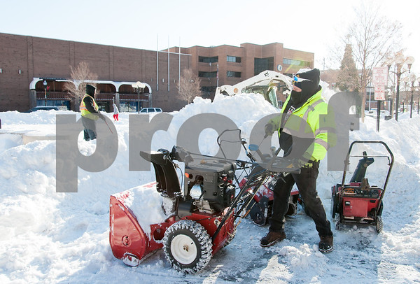 01/05/18 Wesley Bunnell   Staff City workers cleared out Central Park on Friday morning following Thursday's blizzard. Dan Cummings starts up a snowblower to help clear the sidewalks around the park.