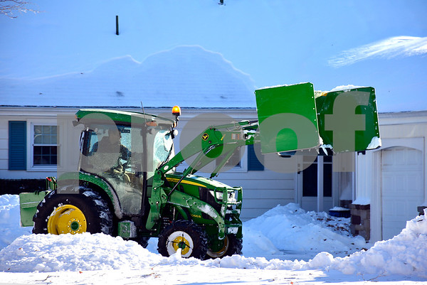 1/5/2018 Mike Orazzi | Staff Rory Ghio uses a John Deere 4066R to clear snow along on Maureen Drive in Bristol Friday afternoon.