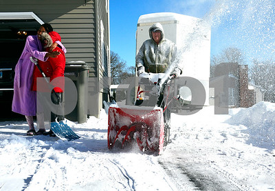 1/5/2018 Mike Orazzi | Staff Lasharette Mauldin hugs her neighor Kathy and Russell Bonaccorso as they clear Mauldin's driveway along Vanderbilt Road in Bristol Friday morning.