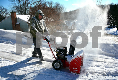 1/5/2018 Mike Orazzi | Staff Russell Bonaccorso clears Lasharette Mauldin's driveway along Vanderbilt Road in Bristol Friday morning.