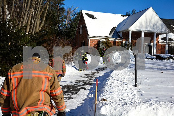 1/5/2018 Mike Orazzi | Staff Bristol firefighters on scene of a report of a fire in electrical conduit on Maureen Drive in Bristol Friday afternoon.