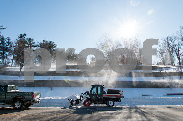 01/05/18 Wesley Bunnell   Staff Swirling winds blow snow drifts on West Main St near Central Park as city workers prepare to work on widening the street on Friday afternoon.