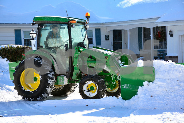 1/5/2018 Mike Orazzi   Staff Rory Ghio uses a John Deere 4066R to clear snow along on Maureen Drive in Bristol Friday afternoon.
