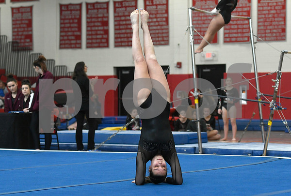 1/6/2018 Mike Orazzi | Staff Bristol Centrals Karissa Ouellette while competing during the floor exercise at the Pomperaug Open held at Pomperaug High School Saturday.