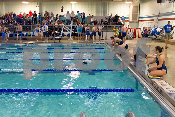 01/19/18 Wesley Bunnell | Staff Plainville swimming was defeated by Southington 97-80 on Friday evening at Plainville High School. Southington's Ben Wakefield ,far lane, and Taegan Brochu for Plainville, near lane, during the 200 free.