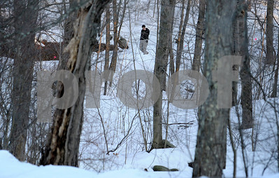 2/23/2011 Mike Orazzi | Staff A Connecticut State Police trooper on Lane Hill Road while investigating a body found by a hiker at Buttermilk Falls in Plymouth on Wednesday afternoon.