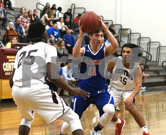 1/9/2018 Mike Orazzi   Staff Plainville's Ben Dougherty (11 and Bristol Central's Jaekwon Spencer (25) and Justus Fitzpatrick (15) at BC Tuesday night.