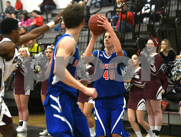 1/9/2018 Mike Orazzi   Staff Plainville's Alec Couture (40) at BC Tuesday night.