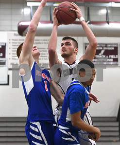 1/9/2018 Mike Orazzi | Staff Bristol Central's Alex Bernier (13) under the hoop at BC Tuesday night.