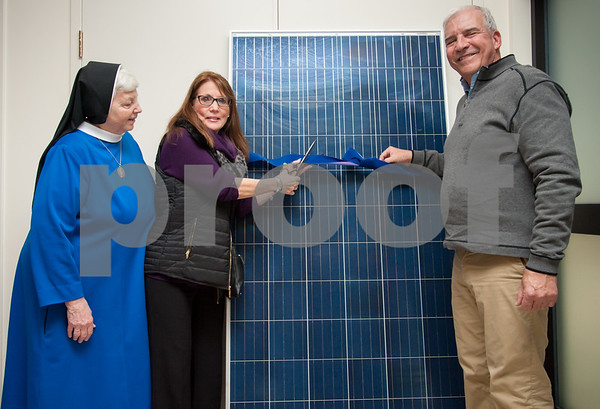 401/09/18 Wesley Bunnell   Staff The Daughters of Mary of the Immaculate Conception presented certificates of appreciation to several businesses for their help in installing solar panels on all of their buildings. Mother Jennifer, L, looks on as Karen Kulak from Associated Real Estate Servies and John O'Brien of EcoSolar LLC cut the ceremonial ribbon on a sample solar panel.