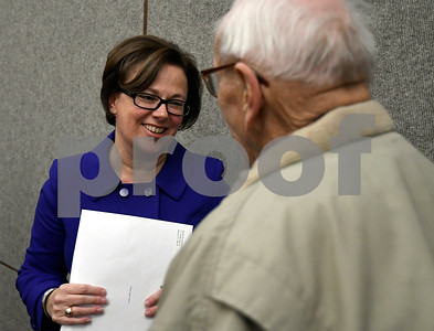1/9/2018 Mike Orazzi | Staff Bristol Mayor Ellen Zoppo-Sassu talks with former mayor Bill Stortz after her official portrait was unveiled Tuesday night at city hall.