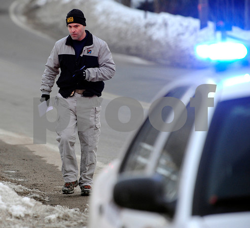2/23/2011 Mike Orazzi   Staff A Member of the Connecticut State Police on Lane Hill Road while investigating a body found by a hiker at Buttermilk Falls in Plymouth on Wednesday afternoon.