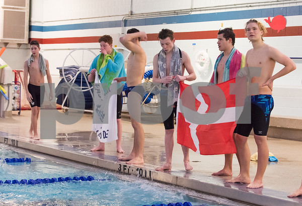 01/09/18 Wesley Bunnell   Staff Plainville boys swimming defeated East Catholic 89-86 on Tuesday evening at Plainville High School. Exchange student from Denmark Morten Fuglsbjerg, R, stands with the Danish flag as he looks at the scoreboard after cheering on a fellow swimmer making the turn in the 400 FR.