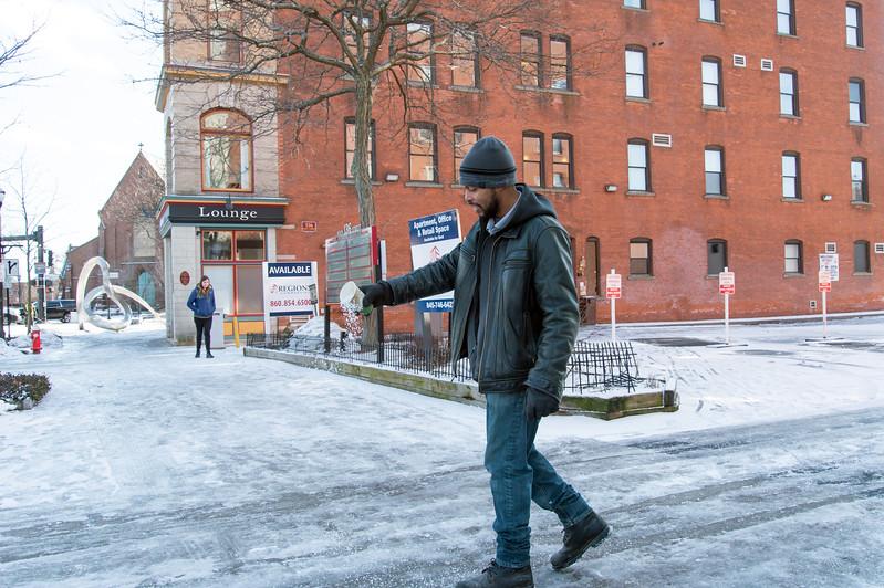 01/29/19  Wesley Bunnell | Staff  Darren Tabron, of Jasko Development, spreads salt onto the walkways around the companies properties on Main St on Wednesday afternoon.