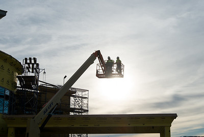 01/28/19  Wesley Bunnell | Staff  Workers are silhouetted in the late afternoon sky as they work on Bristol Hospital's Medical Care Center currently under construction on the corner of Main and Riverside on Monday afternoon.