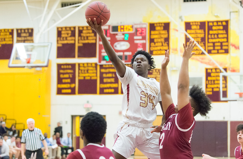 01/28/19  Wesley Bunnell | Staff  New Britain basketball defeated Bulkeley at home on Monday night. Malik Shode (34).