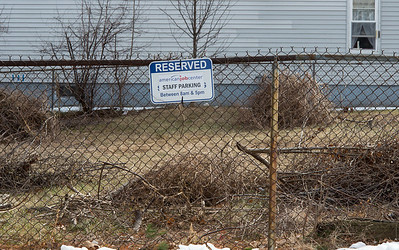 01/28/19  Wesley Bunnell | Staff  Empty reserved parking signs for American Job Center at the Pulaski Democratic Club located at 89 Grove St.