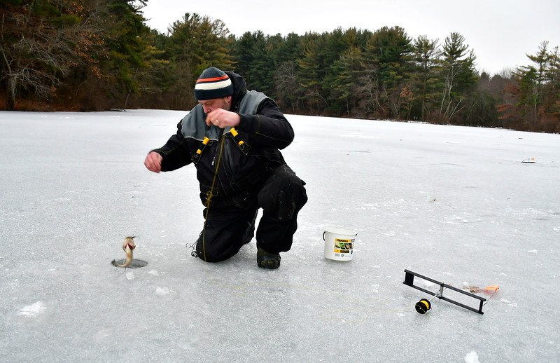 1/29/2019 Mike Orazzi | Staff Tom Grabowski while ice fishing on Pine Lake in Bristol Tuesday afternoon.