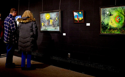 1/10/2019 Mike Orazzi | Staff Bill Herrick and Deb Clen look over art on display during the Greater New Britain Arts Alliance Artist Members Show held at the Stockman Gallery in downtown New Britain Thursday night.