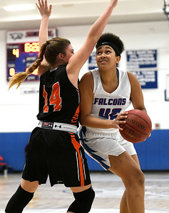 1/11/2019 Mike Orazzi | Staff St. Paul's Jade Udoh (42) and Watertown's Alyssa Santangeli (14) Friday night in Bristol