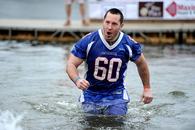 1/19/2019 Mike Orazzi | Staff Southington High School football coach  Mike Drury during the 14th annual Sloper Plunge at Camp Sloper's pond Saturday in Southington.
