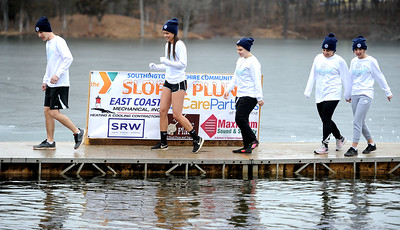 1/19/2019 Mike Orazzi | Staff Jumpers  during the 14th annual Sloper Plunge at Camp Sloper's pond Saturday in Southington.