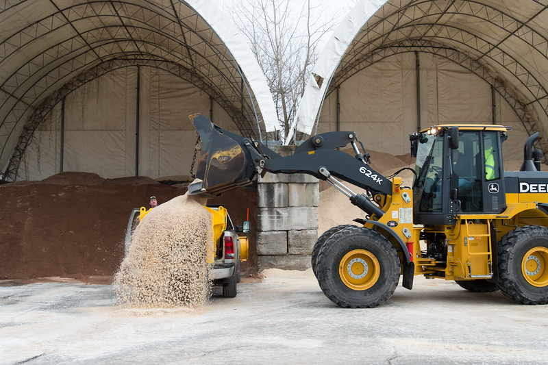 01/17/19  Wesley Bunnell | Staff  Facility Maintenance worker Paul Mankiewicz looks over the back of his truck being loaded with salt by Equipment Operator Sebby Adorno at the New Britain Public Works Department on Friday afternoon.