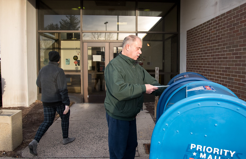 01/02/19  Wesley Bunnell | Staff  New Britain resident David Pagdasarian places his mail in the box at the post office in New Britain on Wednesday afternoon.