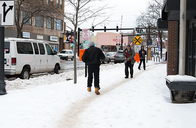 01/23/19  Wesley Bunnell | Staff  Several streets and sidewalks still remain covered in snow and ice on Wednesday after a weekend storm. Pedestrians make their way down an uncleared sidewalk on Main St near the intersection with Bank St.