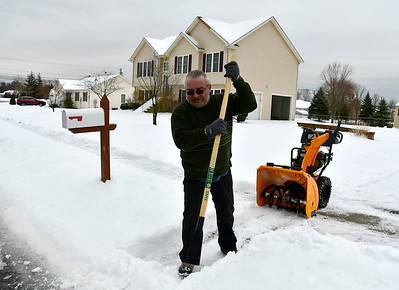 1/23/2019 Mike Orazzi | Staff Svet Vassilev clears ice and snow from a sidewalk along Sunnydale Avenue in Bristol Wednesday.
