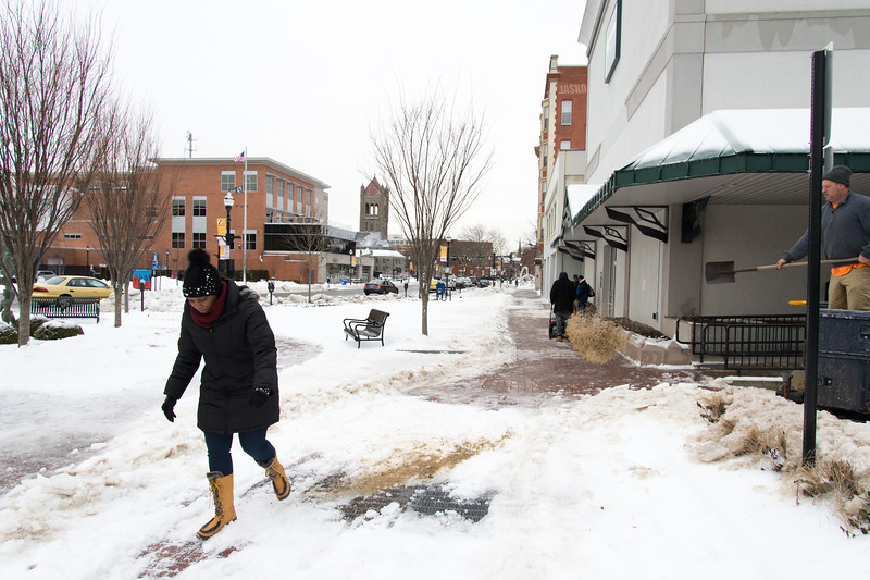 01/23/19  Wesley Bunnell | Staff  Several streets and sidewalks still remain covered in snow and ice on Wednesday after a weekend storm.  A pedestrian makes her way down a snowy sidewalk near Main St and Court St as a private contractor helps clear the area outside of TD Bank.