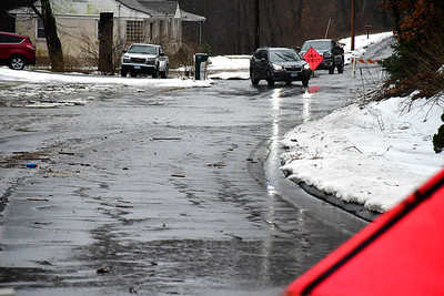 1/24/2019 Mike Orazzi | Staff A partially flooded Old Waterbury Road in Plymouth Thursday.