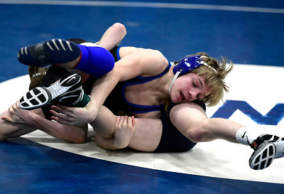 1/26/2019 Mike Orazzi | Staff Bristol Eastern's Mason Lishness and Simsbury's Alex Kasson wrestle at Southington High School Saturday.