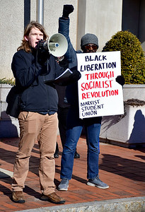 1/26/2019 Mike Orazzi | Staff Members of the CCSU Marxist Student Union Joseph Donnelly and Justin Maynard during a protest Saturday morning in downtown New Britain to protest the decision by an independent state's attorney to not charge five police officers who fired on a carload of men, killing Zoe Dowdell and wounding two others last December.