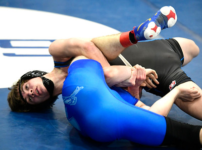 1/26/2019 Mike Orazzi | Staff Bristol Eastern's Gabe Soucy and Southington's Dawsen Welch wrestle at Southington High School Saturday.