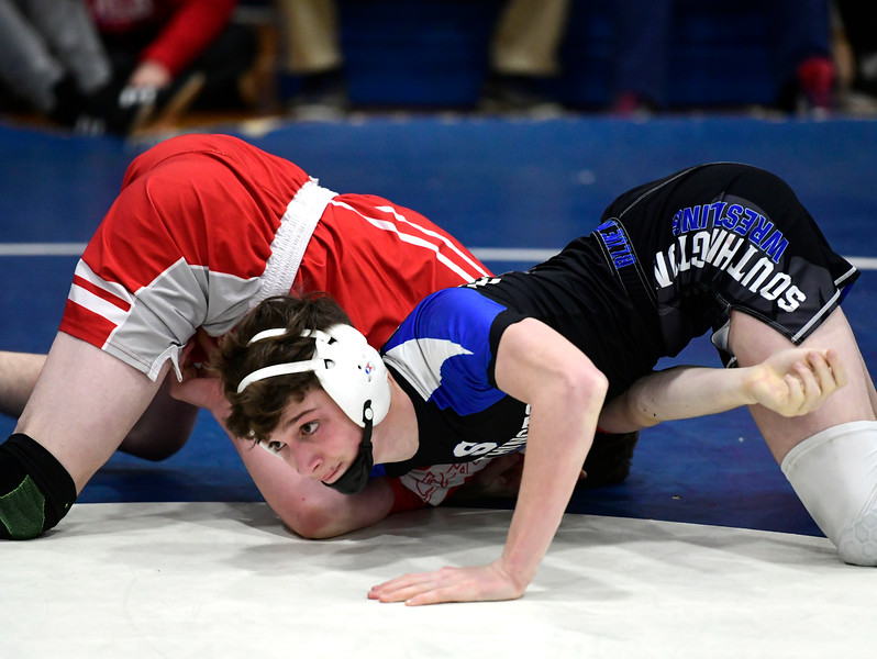 1/26/2019 Mike Orazzi | Staff Berlin's Tyler Barber and Southington's Dawsen Welch wrestle at Southington High School Saturday.