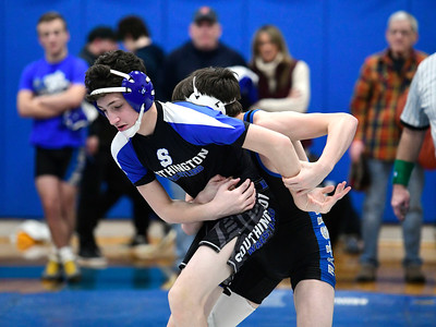 1/26/2019 Mike Orazzi | Staff Bristol Eastern's Riley McCarthy and Southington's Emmett Vitti wrestle at Southington High School Saturday.